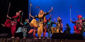 Indian dancers perform on stage in a Dances of the World Showcase.
